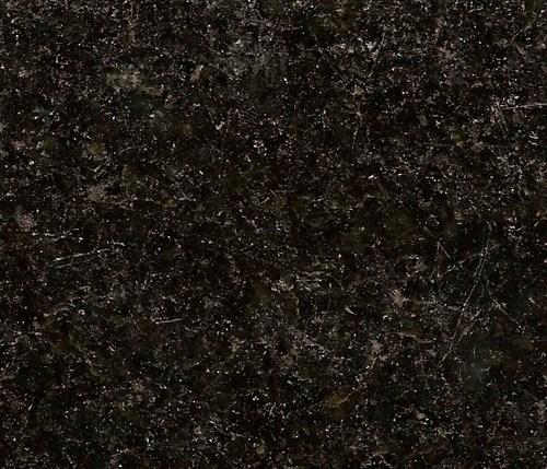 Granito natural cubiertas de corian for Marmol granito negro